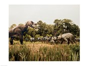 Tyrannosaur standing in front of a group of triceratops in a field