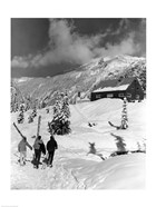 USA, Washington state, three people carrying their skis