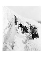 Group of men and women climbing Paradise Glacier in Mt. Rainier National Park, Washington