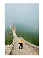 Tourist climbing up steps on a wall, Great Wall of China, Beijing, China