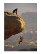 View of rock climbers on the edge of a cliff