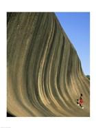 Person climbing Wave Rock, Western Australia, Australia