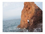Deep Water Solo on a small rock at Point de l'Aiguille