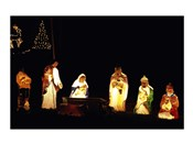 Figurines depicting nativity scene lit up at night