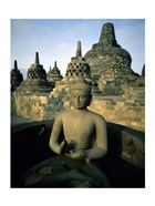 Buddha statue in front of a temple, Borobudur Temple, Java, Indonesia