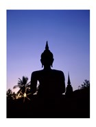 Silhouette of Buddha and temple during sunset, Sukhothai, Thailand