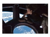 Tracy Caldwell Dyson in the Cupola Observing the Earth during Expedition 24