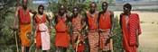 Group of Maasai people standing side by side, Maasai Mara National Reserve, Kenya