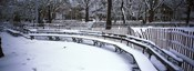 Snowcapped benches in a park, Washington Square Park, New York City