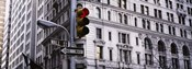 Low angle view of a Red traffic light in front of a building, Wall Street, New York City