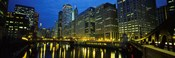 Low angle view of buildings lit up at night, Chicago River, Chicago, Illinois, USA