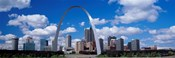 Metal arch in front of buildings, Gateway Arch, St. Louis, Missouri, USA