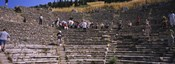 Tourists at old ruins of an amphitheater, Odeon, Ephesus, Turkey
