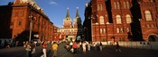 Tourists walking in front of a museum, State Historical Museum, Red Square, Moscow, Russia
