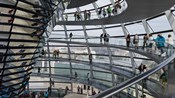 Tourists near the mirrored cone at the center of the dome, Reichstag Dome, The Reichstag, Berlin, Germany