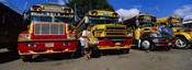 Buses Parked In A Row At A Bus Station, Antigua, Guatemala