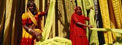 Portrait of two mature women working in a textile industry, Rajasthan, India