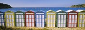 Beach huts in a row on the beach, Catalonia, Spain