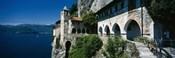 Walkway along a building at a lake, Santa Caterina del Sasso, Lake Maggiore, Piedmont, Italy