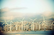 Wind turbines with mountains in the background, Palm Springs, Riverside County, California, USA
