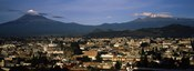 Aerial view of a city a with mountain range in the background, Popocatepetl Volcano, Cholula, Puebla State, Mexico