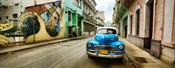 Old car and a mural on a street, Havana, Cuba