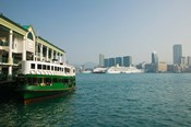 Star ferry on a pier with buildings in the background, Central District, Hong Kong Island, Hong Kong