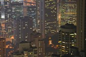 High angle view of buildings lit up at dusk, Central District, Hong Kong
