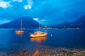 Boats anchored in the Lake Como, Varenna, Lombardy, Italy