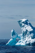 An arched iceberg floating in Gerlache Strait, Antarctica.