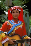 Ethnic Dancer Playing Guitar, Kunming, Yunnan Province, China