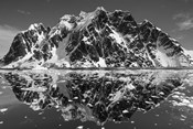Antarctica, Mountain peaks reflected in the Lemaire Channel.