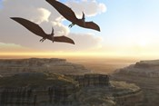 Two Pterodactyl flying dinosaurs soar above a beautiful canyon