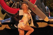 1940's pin-up girl posing with a vintage T-6 Texan aircraft