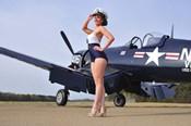 1940's Navy pin-up girl posing with a vintage Corsair aircraft