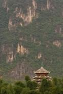 Pagoda and giant karst peak behind, Yangshuo Bridge, China
