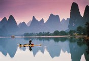 Cormorant fishing at dusk, Li river, Guangxi, China