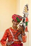 Young Man in Playing Old Fashioned Instrument Called a Sarangi, Agra, India