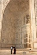 Visitors dwarfed by the Taj Mahal, Agra, Uttar Pradesh, India