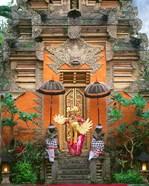 Balinese Dancer Wearing Traditional Garb Near Palace Doors in Ubud, Bali, Indonesia