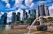 Merlion, symbol of Singapore, and downtown skyline in Fullerton area of Clarke Quay.