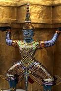 Close-up of beautiful gold decorations at Emerald Buddha in Grand Palace in Bangkok Thailand