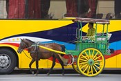 Horse cart walk by colorfully painted bus, Manila, Philippines