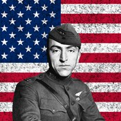 Eddie Rickenbacker in front of the American flag