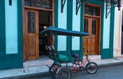 Cuba, Camaquey, bike carriage and buildings