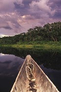 Paddling a dugout canoe on Lake Anangucocha, Yasuni National Park, Amazon basin, Ecuador