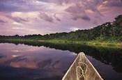Paddling a dugout canoe, Amazon basin, Ecuador