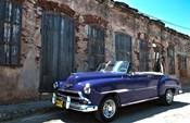 Classic 1953 Chevy against worn stone wall, Cojimar, Havana, Cuba