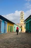 Cobblestone street with cowboy on horse, Trinidad, Cuba