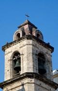 Havana, Cuba Steeple of church in downtowns San Francisco Plaza